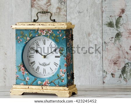 Beautiful handmade clock decoupaged with vintage paper and gold leaf