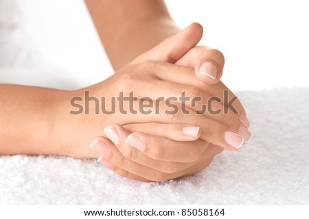 Beautiful hands on the white towel - stock photo