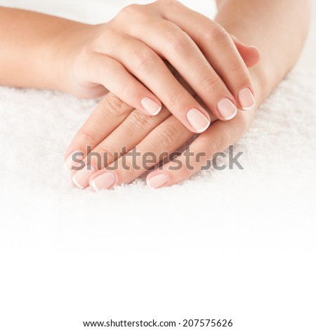 Beautiful hands on the white towel with copy space. - stock photo