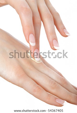 Beautiful hands with perfect nail french manicure and moisturizing cream. isolated on white background