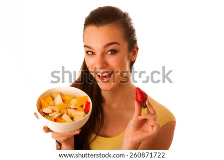 Beautiful happy asian caucasian woman in yellow t shirt eating fruit salad as a healthy lifestyle concept isolated over white - stock photo