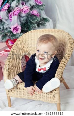 Beautiful happy baby boy with blue eyes - stock photo