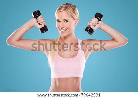 beautiful happy blonde fitness model  on blue background