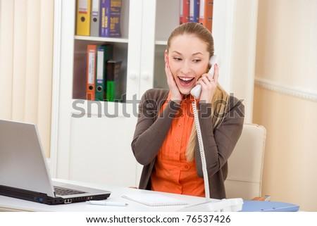 Beautiful happy business woman talking on phone - stock photo