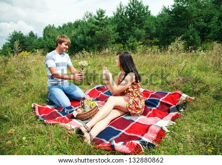 Beautiful, Happy Couple Having Romantic Picnic Together Outside