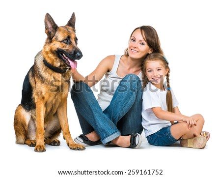 beautiful happy family:  mother with two children and their shepherd isolated on - stock photo