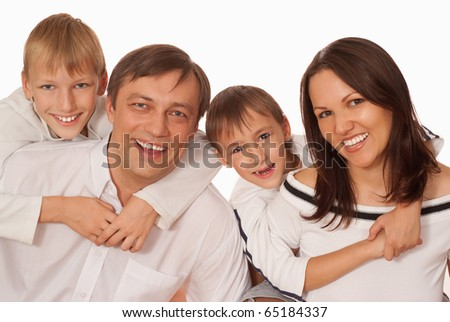 beautiful happy family on a light background