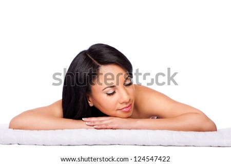 Beautiful happy female face, woman laying relaxing on white towel at spa massage beauty treatment parlor. Healthy Skincare concept, isolated. - stock photo