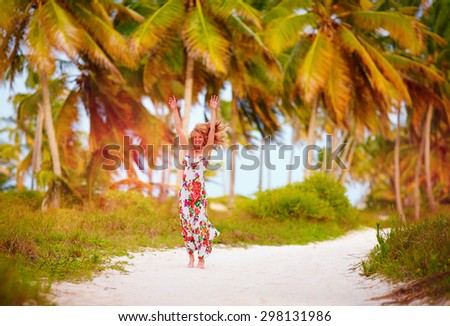 beautiful happy girl enjoy summer vacation in tropical palm grove - stock photo