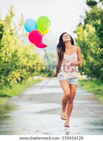 Beautiful Happy Girl Holding Balloons  - stock photo
