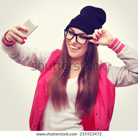 Beautiful happy girl  taking a selfie photo with smart phone  - stock photo