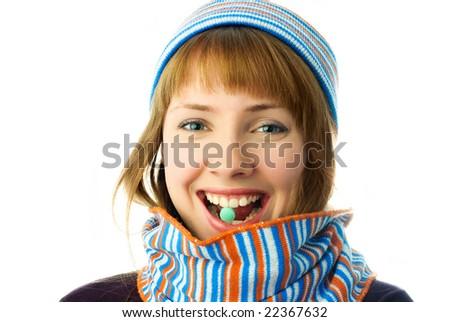 beautiful happy girl taking vitamins isolated against white background - stock photo