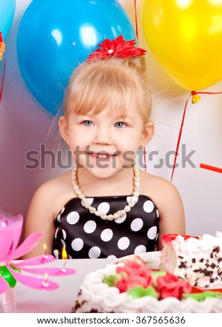 Beautiful happy girl with a bright colored balloons at birthday