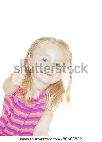 Beautiful Happy Little Blond Girl shows thumb up - stock photo