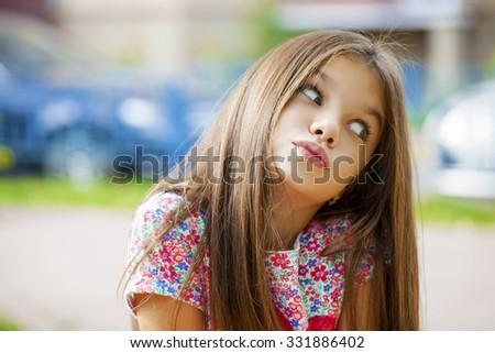 Beautiful Happy little girl outdoors  - stock photo