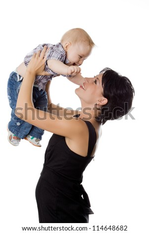 Beautiful happy mather with attractive baby boy on white. Portrait of  baby and his mother. - stock photo
