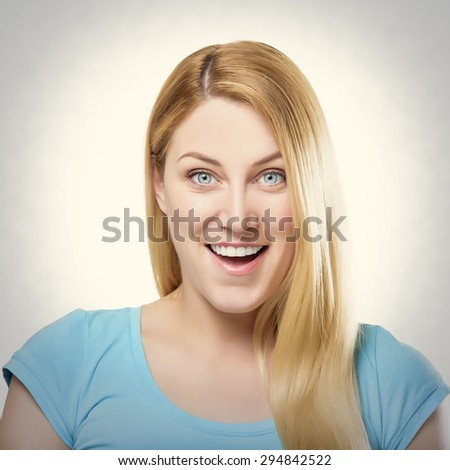Beautiful happy portrait of an young adult smiling blonde woman. Toned photo. - stock photo
