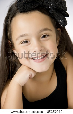 Beautiful happy six year old brunette girl - stock photo