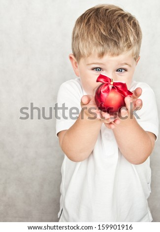 beautiful happy small boy with christmas ball - stock photo