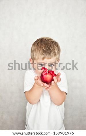 beautiful happy small boy with christmas ball - stock photo