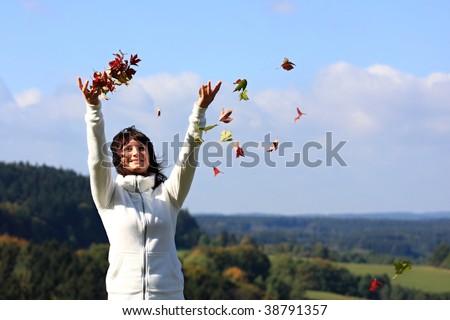 Beautiful happy smiling autumn girl - stock photo