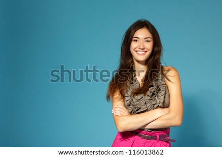 beautiful happy smiling teen girl over blue background - stock photo