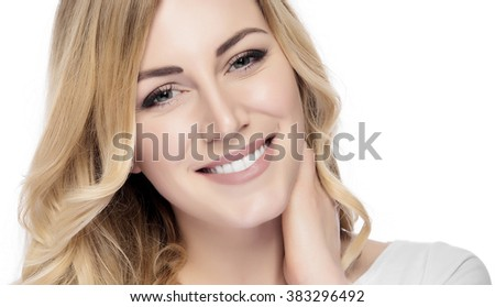 Beautiful happy smiling young blonde woman isolated on white. - stock photo