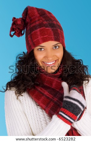 beautiful happy winter girl isolated on blue background