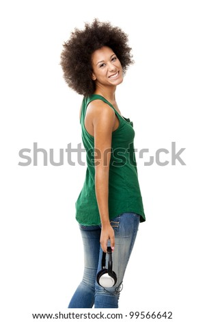 Beautiful happy woman holding headphones, isolated on white backgorund - stock photo