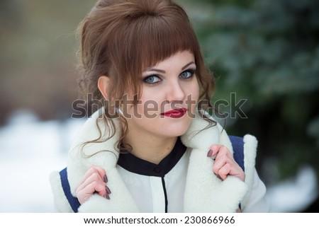 beautiful happy woman in coat walking street - stock photo