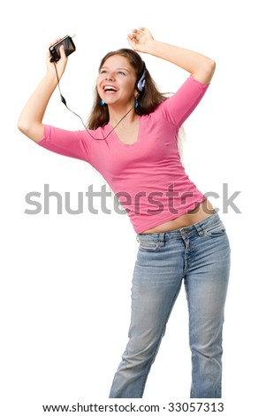 Beautiful happy woman in pink jacket and jeans dance with music player, isolated on white