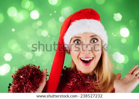 Beautiful happy woman in santa claus hat  - stock photo