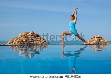 Beautiful happy woman in yoga poses - stock photo
