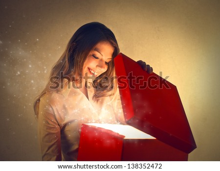 beautiful happy woman opening gift box - stock photo
