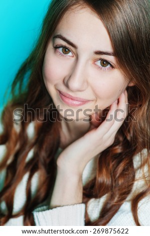 Beautiful happy woman posing in studio closeup. - stock photo