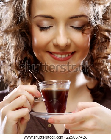 beautiful happy woman with a cup of espresso coffee - stock photo
