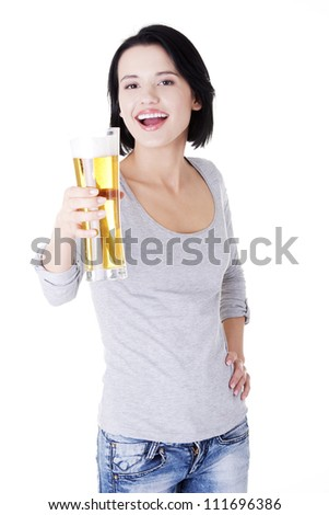 Beautiful happy woman with glass of beer, isolated on white - stock photo