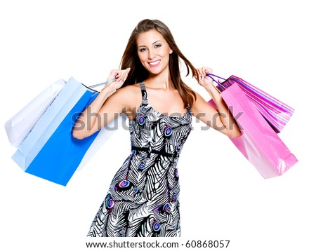 Beautiful happy woman with shopping bags isolated on a white background