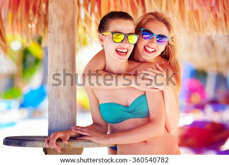 beautiful happy women, friends enjoy summer vacation on tropical beach - stock photo