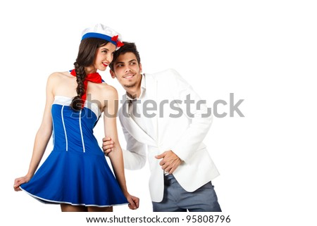 Beautiful happy young couple of elegant man and sailor woman looking away. Isolated on white background. High resolution studio image - stock photo