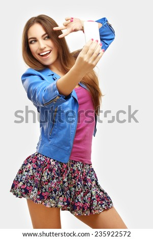 Beautiful happy young mixed race girl taking a selfie photo with smart phone  - stock photo