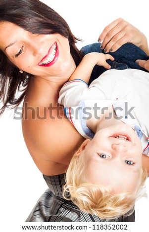 Beautiful happy young woman having fun with child boy, isolated on white background. - stock photo