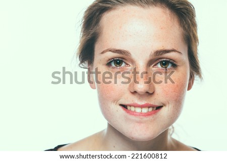 beautiful  happy young woman portrait face  with freckles and smile  - stock photo