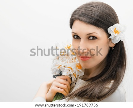 beautiful happy young woman with a bouquet of flowers in her hands - stock photo