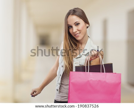 beautiful happy young woman with shopping bags