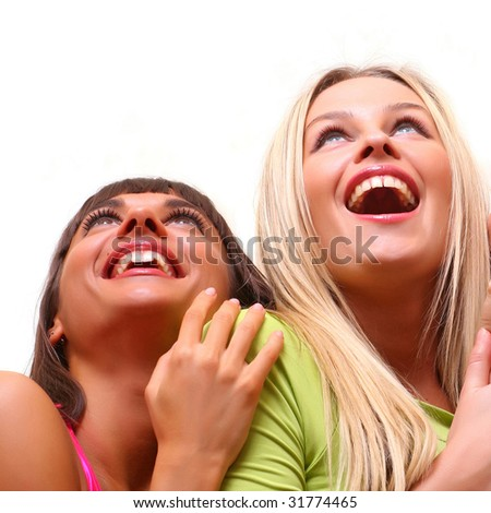 beautiful happy young women with a smile in bright multi-coloured clothes look upwards, isolated on a white background, please see some of my other parts of a images