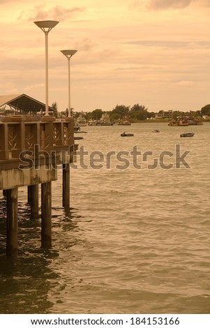 beautiful harbour view at sunset - stock photo