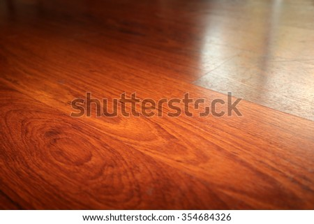 Beautiful Hard Wood Flooring with reflections from a window. - stock photo