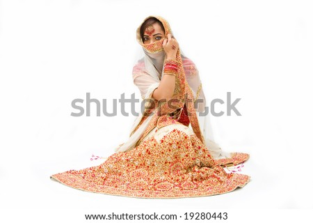beautiful harem girl or belly dancer or Hindu bride sitting, isolated