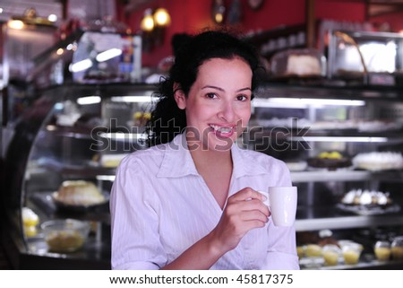 beautiful having a coffee break at a pastry shop - stock photo
